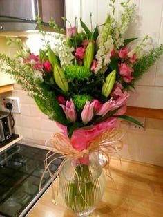 Long tall open bouquet arranged by Jane Harrison
