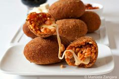 """<p><span style=""""font-size: 11.0pt; line-height: 115%; font-family: 'Calibri','sans-serif';"""">Fried rice balls filled with mozzarella whose name means supplì """"on the phone,"""" because the cheese inside of them stretches like the cord of a telephone! Get the recipe <a href=""""http://www.manusmenu.com/suppli-al-telefono"""" target=""""_blank"""">HERE</a>.</span></p>"""