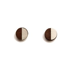 Turpentine Josephine Small Walnut & Brushed Steel Earrings: These little Josephine Walnut & Brushed Steel Earrings are part of a brand new mixed material jewellery collection designed in-house by Jude de Berker and exclusive to the Turpentine.  Inspired by time spent in her dad's carpentry workshop as a child and her training as a jeweller at Central Saint Martins the range mixes solid walnut wood with brushed steel, copper, brass and 100% solid silver earrings backs and findings.  The…