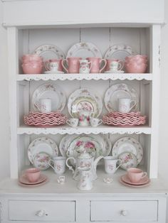 Vintage pink roses with pink ruffled china.  The old with the new.  Breakfast nook.