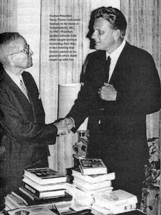 Billy Graham giving former Pres. Harry S. Truman a  Masonic handshake while…