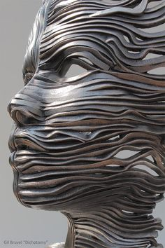 Perceiving the Flow: Human Figures Composed of Unraveling Stainless Steel Ribbons by Gil Bruvel steel sculpture