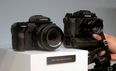 At Photokina camera makers carve out their territory