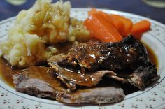 Roast haunch of wild boar in a mustard crust with celeriac and potato mash
