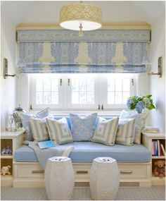 Built-in window seat, low shelves & wall sconces