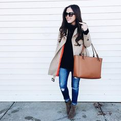 Corilynn. Black knit sweater+distressed jeans+brown ankle boots+beige trenchcoat+camel tote bag+sunglasses. Winter Casual Outfit 2017