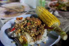 Stir fry (and corn) at the night market in Chiang Mai, Thailand.
