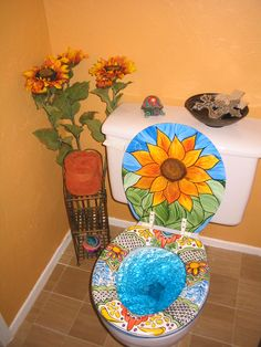 Mexican Talavera inspired painted toilet seat and lid. The seat matches my sink. Used black Sharpie and acrylic paints, sealed.