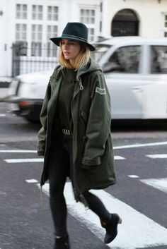 Green parka with black felt hat