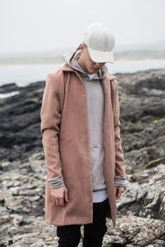interesting hoodie + top coat. i can't tell if this works or if its just the pic.