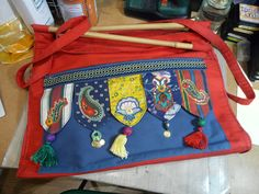 Tasselled Bag. Machine applique with shisha embroidery and miscellaneous embellishments, hand-made tassels.