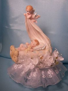 Angel Above a Sleeping Baby Boy Christening Baby Shower Cake Top Decoration Centerpiece by Party Favors Plus. $20.00. Angel Above a Sleeping Baby Boy Christening Baby Shower Cake Top Decoration Centerpiece 7 inchest tall made on a 4 inch wide base