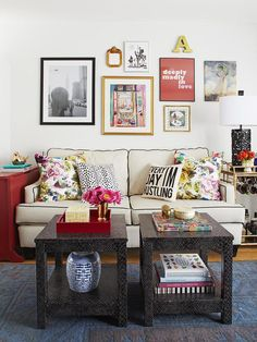 Eclectic family room with floral pillows, collage frame wall, awesome paired coffee table