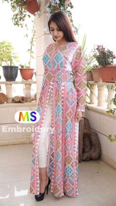 indian designer wear Jordanian Palestinian Embroidered Beautiful dress / Thobe with tatreez Palestinian cross stitch /embroidery details on front and back Some time the pattern com Pakistani Fashion Casual, Pakistani Dress Design, Pakistani Dresses, Indian Dresses, Indian Outfits, Indian Designer Outfits, Designer Dresses, Afghani Clothes, Kaftan Designs