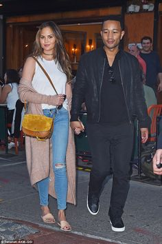 Date night! Chrissy Teigen and her husband John Legend were spotted hand in hand after a romantic dinner for two at Bar Pitti in New York City on Monday night