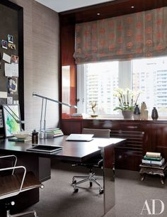 Vicente Wolf designed the walnut-and-steel partners desk in actress Julianna Margulies's Manhattan home office.