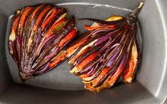Fancy, classy, tasty, and totally vegan! These roasted eggplant fans are vibrant and double as a centerpiece for your dinner table!