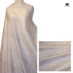 """This brocade with a graphic """"crocodile skin"""" design has a white-on-white coloration, but the metallic thread in the fabric makes the background appear as a higher-sheen silver white.  - See more at: https://fabrics-fabrics.com/index.php?id_product=77&controller=product#sthash.DLiZ8p7y.dpuf"""