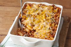 Cheesy Pasta Bake: Cheesy with cheddar and full of mushrooms, bacon and spaghetti sauce, this pasta bake is comfort food at its most delicious.