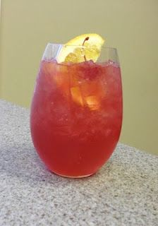 Oaks Lily...Basic recipe is 1 oz. vodka, 1 oz. sweet and sour, 3 oz. cranberry juice, splash of triple sec
