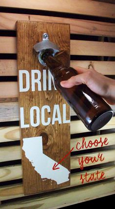 "Here we have a sturdy bottle opener made from solid hard wood. It attaches directly to the wall for convenient bottle opening, and doubles as a lovely piece of handcrafted decor. Each wall-mounted bottle opener is simply screen-printed with ""Drink Local"" and a state silhouette of your choice in white. If there's a better reason than beer to support local, we haven't heard it. Nor do we want to."