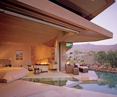 contemporary bedroom with pool overlooking mountains