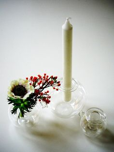 These candle and flower holders draw attention without calling for attention. They'll create a refined focal point on your table without making a loud statement. Perfect for the holidays, or a dinner party any time of the year.
