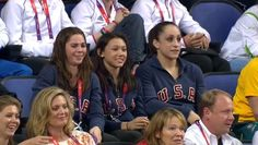 McKayla, Kyla, and Jordyn cheering Aly and Gabby on in the all-around