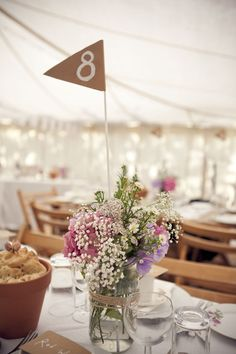 Sweet and super DIY-able table numbers | http://www.weddingpartyapp.com/blog/2014/10/23/5-easiest-diy-wedding-ideas/