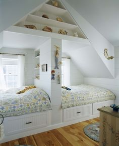 bedroom in attic....like the use of the space below the eaves.