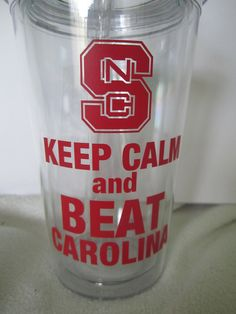 NC State. Keep Calm and Beat Carolina. Clear insulated tumbler with North CarolinaState design in red. Personalize with name monogram.. $12.50, via Etsy.