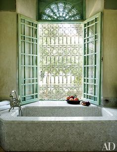One of the baths in an 18th-century Marrakech riad features green walls and a tiled tub.