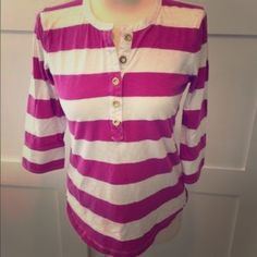 J Crew Pink Rugby Stripe 3/4 Sleeve Henley Tee J Crew 3/4 sleeve pink and white rugby stripe henley tee. This shirt has been worn and has a couple of small pin holes on the bottom hem. (Please see last photo.) **Low price reflects damage. J. Crew Tops Tees - Long Sleeve