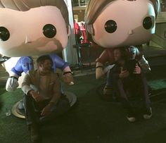 Jensen & Jared with their giant Funko Pop figures