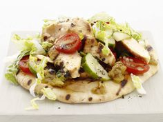 These little pita pockets are tasty and healthy, with  grilled chicken, plenty of fresh vegetables and topped with a zesty sauce.