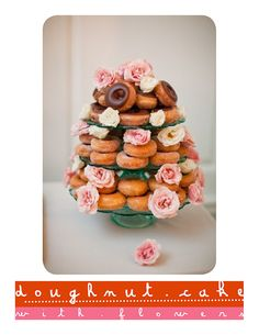 Donut cake with pink flowers.