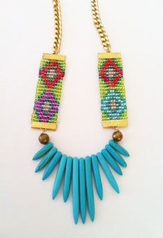 Hand beaded Adorn statement necklace from Shh by Sadie. Glass seed beaded Aztec pattern straps with turquoise howlite spikes, vintage gold beads and gold curb chain. Available online through Etsy. Designed and handmade by Sadie Hawker in Wellington, New Zealand. Shhbysadie.com