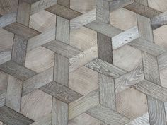Oak parquet floors by Ateliers des Granges. Center hexagons: end- grain.