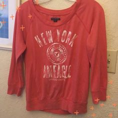 American Eagle Outfitters 3/4 Sleeved Graphic TeeM AEO graphic tee 3/4 sleeved orange w white graphic , gently worn , M American Eagle Outfitters Tops Tees - Long Sleeve