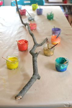 Collaborative branch painting, collaborative art, small group, art, nature, natural materials