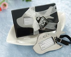 Have your boarding pass ready and grab your carry-on!  Travel buffs and frequent fliers alike will adore the utility of this special little airplane wedding favor.  What a great way to thank your guests for traveling to your event.  Each airplane shaped luggage tag wedding favor is forged from heavy weight chrome and adorned with three heart shaped passenger windows. Attached is a black adjustable leather strap. These luggage tags could easily double as place card holders.  Size: Measures 3…