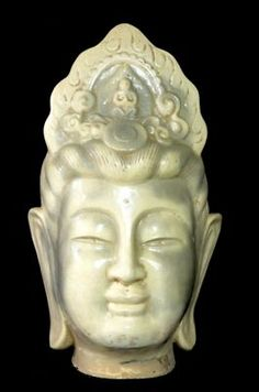 This Ivory White statue head is a depiction of Kwan Yin, the Bodhisattva of Compassion.