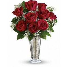 Traditional elegance. A handful of classic red roses look especially stunning in a silver mercury vase accented with delicate, million star gypsophila.