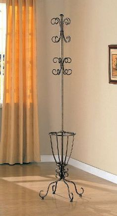 """Elegant Antique Gold Finish Metal Coat Rack by Coaster Home Furnishings. $37.00. Simple Assembly Required. Umbrella Holder. Curved Accents. Liquid Metal Finish. Dimension: 20""""L x 14""""W x 76.25""""H Finish: Antique Gold Material: Metal Elegant Antique Gold Finish Metal Coat Rack This elegant coat rack features an umbrella holder with curved accents on the foot and top. The look is completed with an upscale liquid metal finish. Simple Assembly Required."""