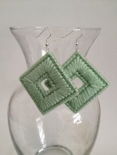 Plastic canvas diamond earrings with a hole.
