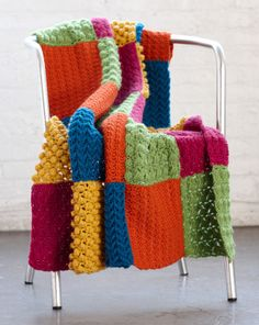 Crocheted throw. Hate to crochet but really like this. Change the colors though, it's a little bright.