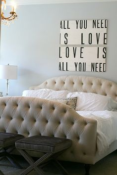 ...I also need a little more color goin' on --- but I DO love the signs above the bed!  Great sense of style in this house...