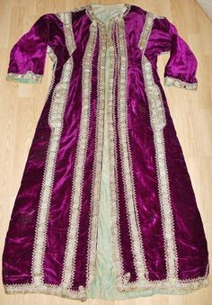 Woman's festive caftan, from Central Anatolia.  Late-Ottoman era, ca. early 20th century.  Non-Muslim (probably 'Rum' / Anatolian Greek).  Silk velvet, adorned with gold thread embroidery, golden braid and cordage.  (Source: Antika Osmanlı Tekstil, Istanbul).