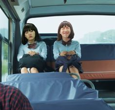 Yoonja and Yojoon sitting on a bus together