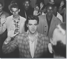 Elvis Presley is sworn into the Army on March 24, 1958 at Fort...
